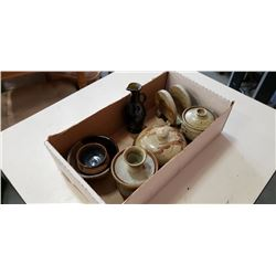 Box of signed pottery