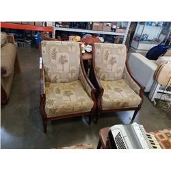 PAIR OF STUDDED WOOD FRAMED ARM CHAIRS WITH TREE PATTERNS