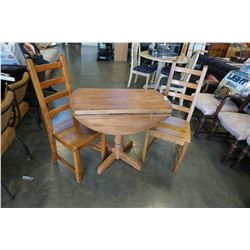 ROUND DROPSIDE DINING TABLE AND 2 PINE CHAIRS