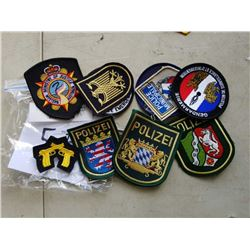 11 RARE INTERNATIONAL  POLICE PATCHES - RETAIL $275