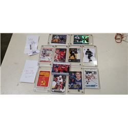 Lot of plastic cased NHL Pittsburg penguin cards and russian star rookie cards