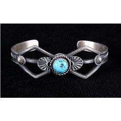 Navajo Silver Sand Cast Kingman Turquoise Bracelet