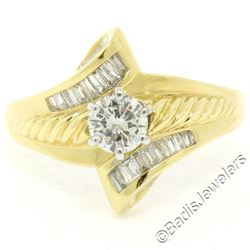 18kt Yellow and White Gold 0.90 ctw Round and Baguette Diamond Ring