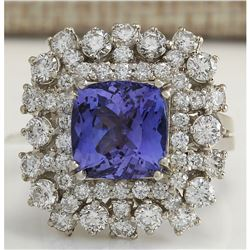 7.57 CTW Natural Blue Tanzanite And Diamond Ring In 18K White Gold