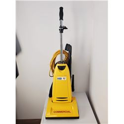 Carpet Pro Upright Commercial Vacuum With Metal Agitator, With Tools.   It is in great shape and com