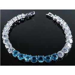 .925 Silver Blue Topaz and White Swarovski Element Bracelet.