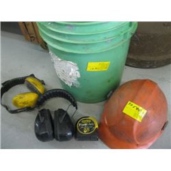 GREEN BUCKET WITH ASSORTED EAR MUFFS, TAPE MEASURE, HARDHAT ETC.