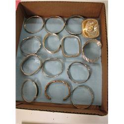 BOX OF SILVER COLOR BRACELETS, BELT BUCKLE