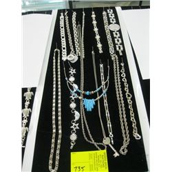 A LOT OF SILVER COLOR NECKLACES AND BRACELETS