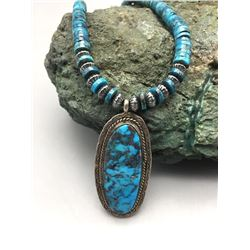 High-grade Turquoise Pendant on a Disk Bead Necklace
