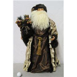 Santa w/ Tasseled Coat Holding Pine & Fruit