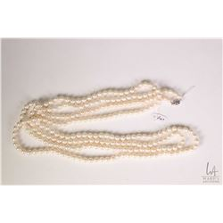 "Strand of freshwater cultured 74"" pearl necklace with white metal clasp. Retail replacement value $1"