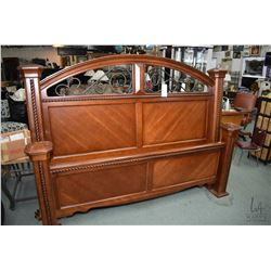 King sized headboard, footboard and rails with wrought iron and carved rope style accents