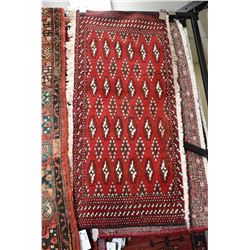 "100% handmade Iranian scatter rug with red background and geometric pattern 16"" X 41"""