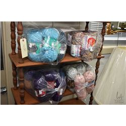 Four large bags of wool including Loops & Threads, Brunswick, Red Heart, Home Spun etc.