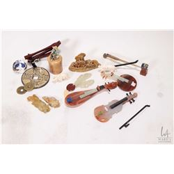 Selection of Oriental miniatures and small collectibles including soapstone instruments, carved elep