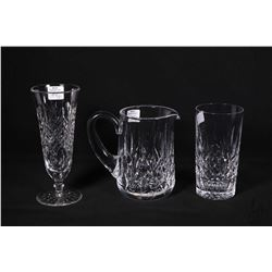Three pieces of Waterford Lismore crystal including 1 pint water jug, a 12 oz. tumbler and a footed