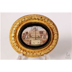 Antique 18kt yellow gold and micro mosaic brooch featuring St. Peter's Square in Vatican City. Circa