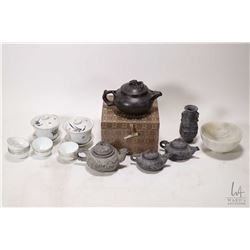Selection of Oriental tea items including miniature tea service, a black clay tea pot in fitted box