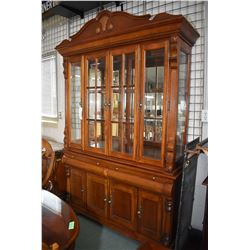 Chest on chest breakfront china cabinet with illuminated top section, glass doors and shelves and ra
