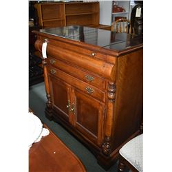 Multi drawer and two door serving/ sideboard with fold over top to exposed protected serving surface