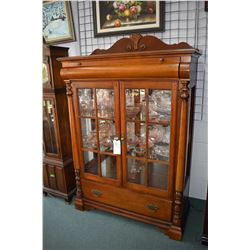 Display cabinet with illuminated top section, glass doors and shelves and drawers on both top and bo