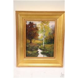Gilt framed acrylic on canvas painting titled on verso Landscape with a Stream and initialled by art