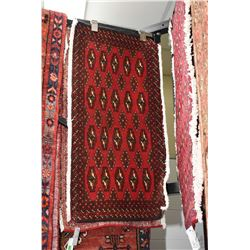 "100% handmade Iranian scatter rug with red background, 18"" x 38"""
