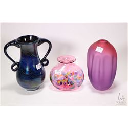 "Three pieces of art glass including 8 1/2"" frosted amethyst vase signed Tsunami 2017, a blue iridesc"