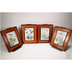 """Four framed hand painted Oriental floral and bird motif glazed tiles, each 11"""" X 9"""" in overall dimen"""