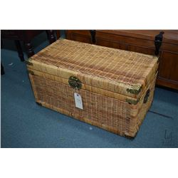 Wicker hinged lidded trunk with glass top, used as coffee table