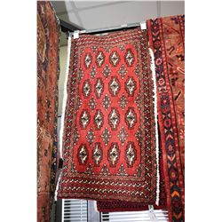 "100% handmade Iranian scatter rug with red background, 19"" X 40"""