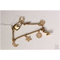 Birks 18kt yellow gold charm bracelet with seven 18kt gold charms. Retail replacement value $6,200.0