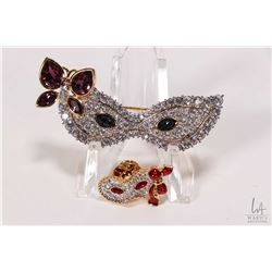 Two Swarovski crystal masks including brooch and pin