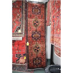100% handmade Iranian Karajeh wool carpet runner with multiple medallion, red background and highlig
