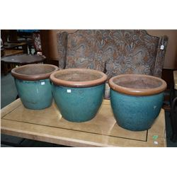 "Set of three matching glazed pottery planters, 13"" in height. Note: No Shipping. Local Pickup Only"
