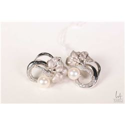 18kt white gold, pearl and diamond earrings set with .38ct of round full cut white diamonds and two