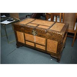 Heavily carved Oriental themed camphor wood chest with tray and brass hardware