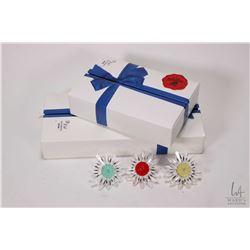 Three boxed Swarovski Collector's Society crystal daisies