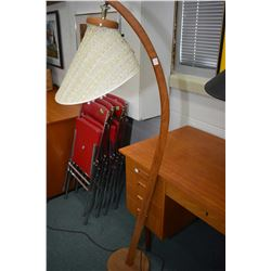 Mid century modern teak floor lamp with woven slightly distressed shade
