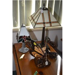 Three small table lamps with leaded glass shades including butterfly, holly and berries motif and a