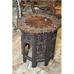 Heavily carved octagonal folding table with hinged sides decorated with grape and leaf design