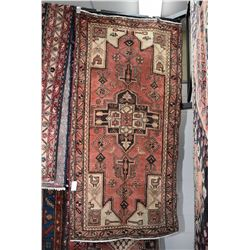 100% Iranian Hamdan wool area carpet with center medallion, stylized animals and floral, soft red ba