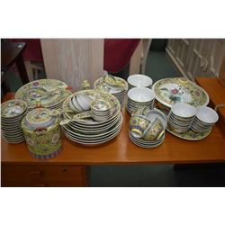 Large selection of Chinese famille jaune dinnerware including rice bowls, plates, teapot, lidded ser