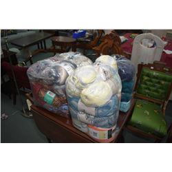 Four large bags of wool including Red Heart, Caron Cakes, Loops & Threads etc.