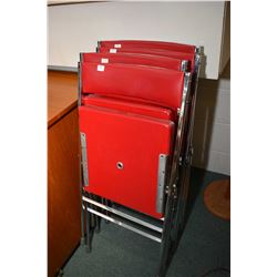Set of four red upholstered and chrome folding chairs