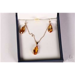 """10kt yellow gold and topaz gemstone set earrings with matching pendant on a 10kt yellow gold 15"""" nec"""