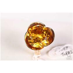 10kt yellow gold flower motif ring set with large topaz gemstone