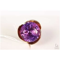 10kt yellow gold flower motif ring set with large amethyst gemstone