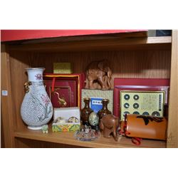 Shelf lot of mostly Asian collectibles including cork diorama, clay figure, antique coin display, cl